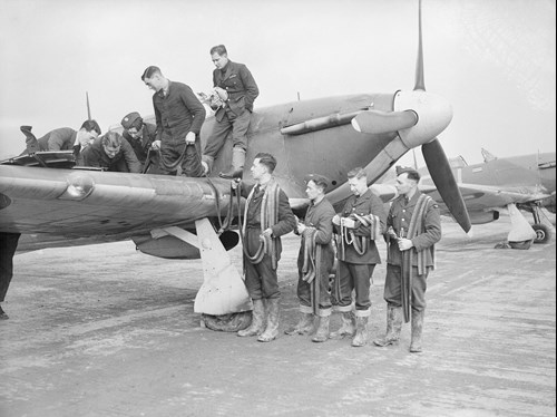 RAF Hurricane fighter plane being rearmed by ground crew