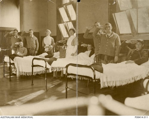 Informal portrait of nine wounded soldiers and two nurses